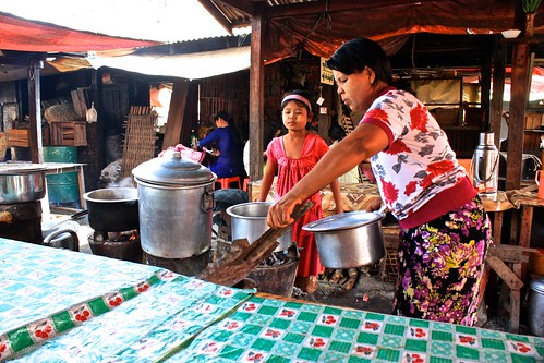 Making lunch over special wood stoves at the market in Nyaungshwe, Myanmar