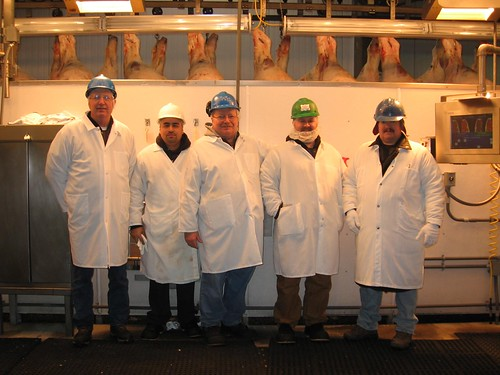 USDA Certified Industry Beef Graders pause for a picture. Pictured are Glen Powers, Albert Navarro, Mike Schulp, Jeremy Schuoler, and USDA grader Cory Barnes. Adapting new strategies for meat grading helped one company reduce meat grading costs for by 50 percent.