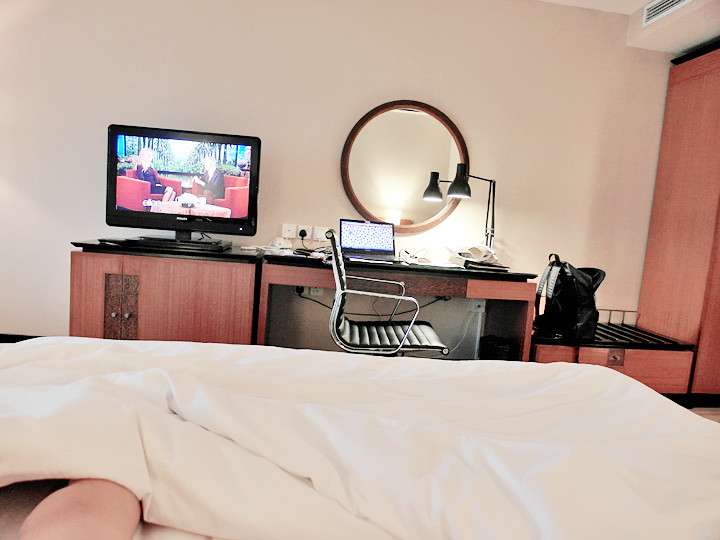 grand mercure roxy hotel on bed watching tv