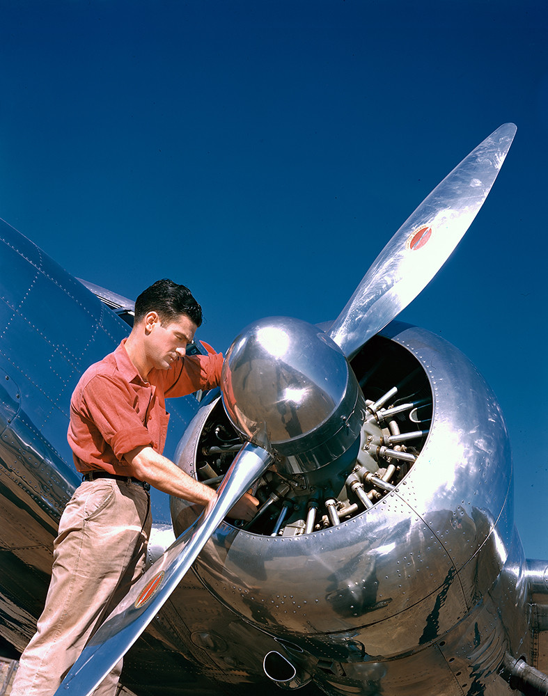 [Aviation Mechanic with Lockheed 12A Electra Junior]