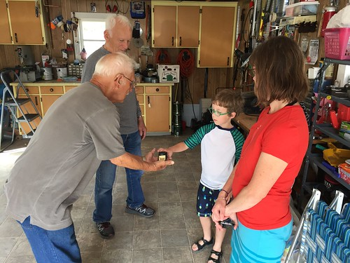 Uncle Dick gives Ian a car.  Rogers City Michigan, August 15 2016.