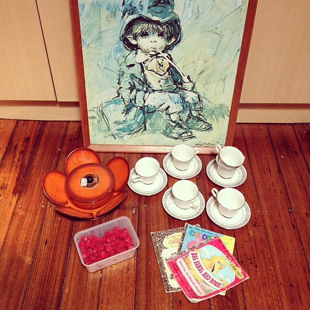 Today's market finds: sad smoking child print, seventies serving set, nice old tea set, some Golden Books and raspberries.