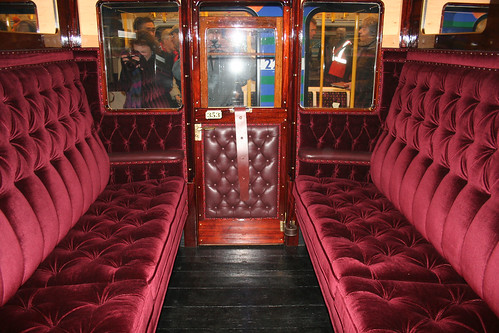 The plush interior of the restored carriage