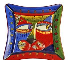 textile(0.0), furniture(0.0), bed sheet(0.0), pillow(0.0), cushion(0.0), throw pillow(1.0),