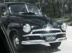 pontiac chieftain(0.0), chevrolet fleetline(0.0), mid-size car(0.0), plymouth deluxe(0.0), automobile(1.0), automotive exterior(1.0), vehicle(1.0), buick super(1.0), compact car(1.0), antique car(1.0), classic car(1.0), vintage car(1.0), land vehicle(1.0), luxury vehicle(1.0),