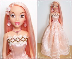 blond(0.0), nose(1.0), face(1.0), gown(1.0), peach(1.0), pink(1.0), dress(1.0), doll(1.0), barbie(1.0), toy(1.0),