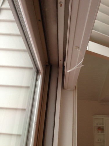 upper corner sliding door with blinds