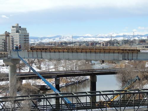 Photo of construction workers on the South Platte River commuter rail bridge