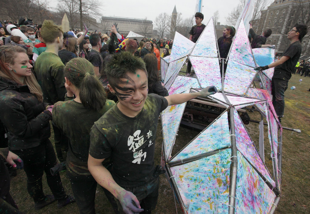 First-year students celebrate their successful march around campus and arrival on the Arts Quad during Dragon Day 2013.