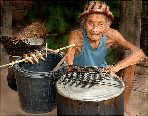 Lao man with grilled fish