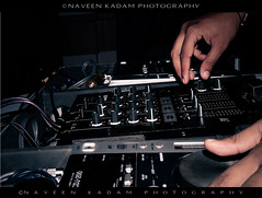 keyboard player(0.0), musician(0.0), musical keyboard(0.0), drums(0.0), monochrome(0.0), entertainment(1.0), disc jockey(1.0), person(1.0), electronic instrument(1.0),
