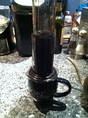 AeroPress coffee maker on top of mug.