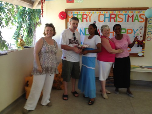 Pat & Marie give Mama Domi & Auntie Grace from Maguire House their presents