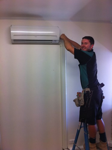<p>Adam installing a Hitachi RAK-25 multi head wall split in a commercial office.</p>