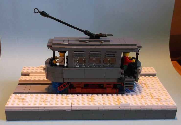 Side view of a LEGO® model of a snowbroom tram