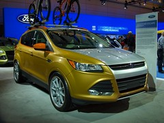 race car(0.0), automobile(1.0), automotive exterior(1.0), sport utility vehicle(1.0), mini sport utility vehicle(1.0), vehicle(1.0), automotive design(1.0), compact sport utility vehicle(1.0), crossover suv(1.0), ford escape(1.0), bumper(1.0), ford(1.0), land vehicle(1.0),
