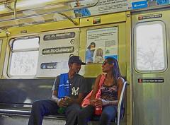 USA, NY, Queens, Long island, flirting on the subway enroute to Far Rockaway