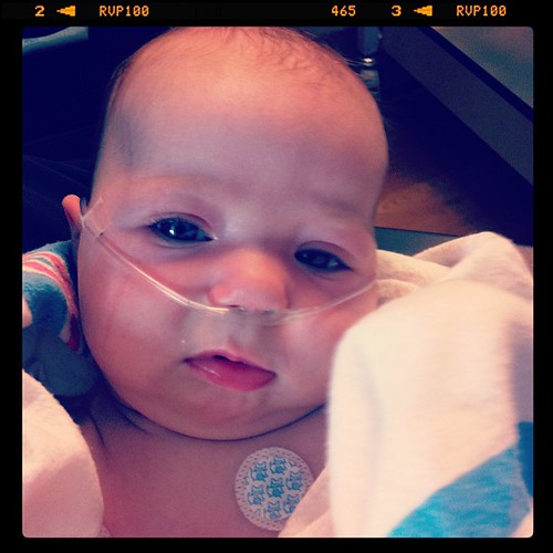 Sweet girl is on oxygen, lots of suctioning, breathing treatments, and lots of cuddling with her mommy and daddy.