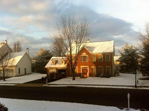 Sunrise on a snowy morning puts a coat of white on all the houses