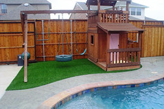 Synthetic grass under a playset
