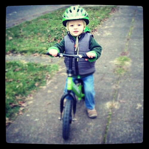 "True was gifted  a hand me down bike and this kid is all over it. We met a new neighbor friend the other day. ""Oh you have the child that we often see flying down the sidewalk on the bike or scooter. "" Yes. That sounds about right. He is two vibrant, aliv"