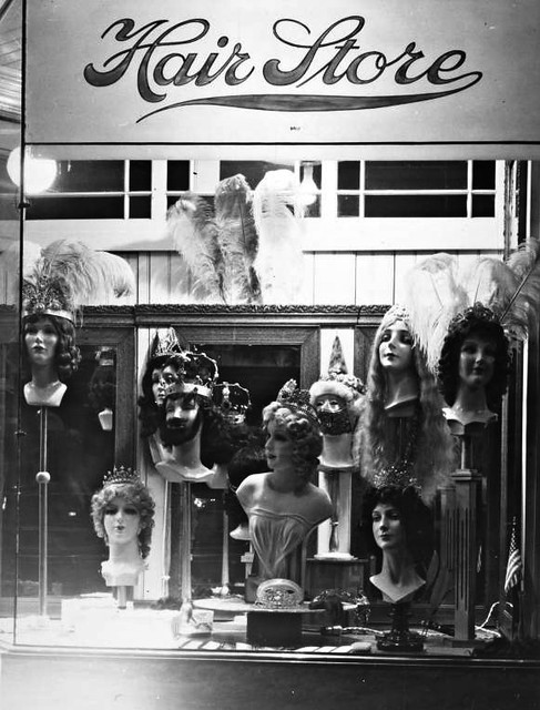Mardi_Gras_wigs_and_costume_jewelry_in_store_window_in_New_Orleans_Louisiana_in_1940s