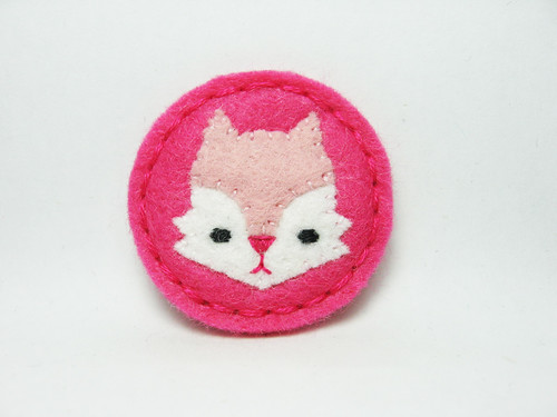 Tiny pink serious fox felt pin