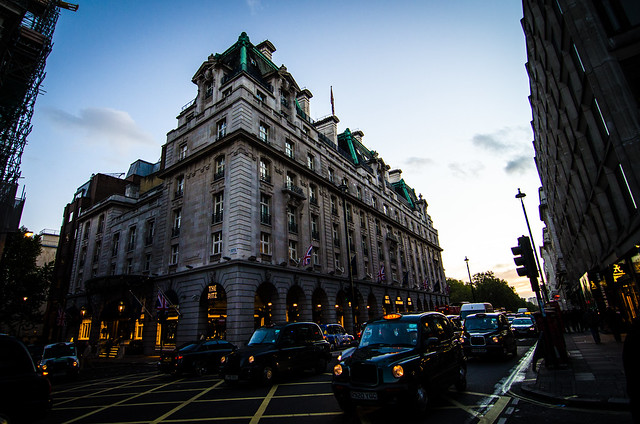 sunset and black cabs at the ritz in London England