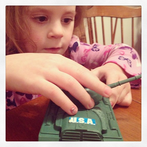 "Avi chose to play with a toy tank at the table today. We talked about the letters on the front and she recognized the S and the A. We then asked her if she knew what the United States of America was. ""Umm, I think it's where the good guys live?"" #kidssayt"