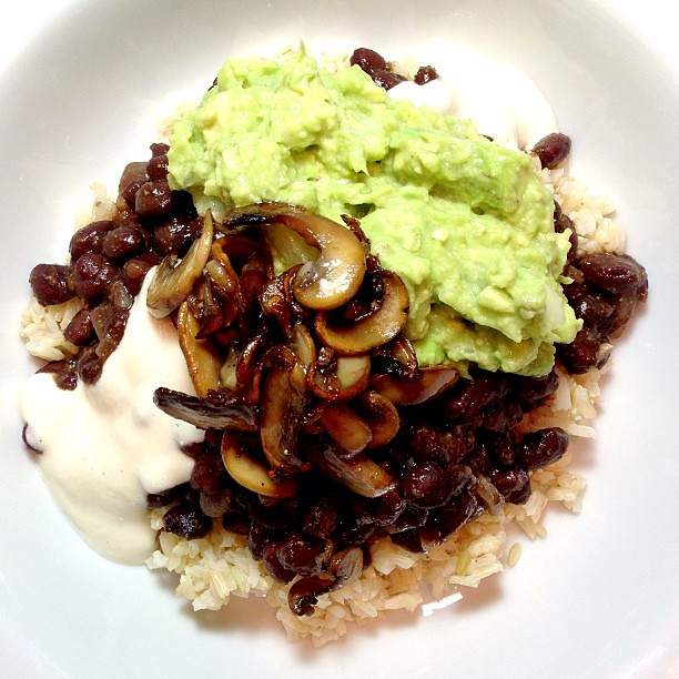 Dinner: Supreme Rice and Beans! Beans, brown rice, cashew cream, guacamole and fried garlicky mushrooms! #vegan