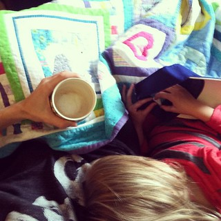 Snuggled up Gigi, a latte and our first Sparkle Stories audio book, on a rainy day. #homeschoolingisawesome