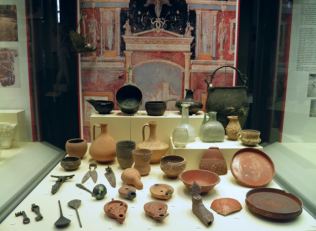 Ancient Roman oil lamps, bronze and glass objects and tableware, Civico museo archeologico di Milano