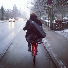 The Saxofonist on the Red Bicycle. #saxophone #copenhagen #cyclechic #vikingbiking