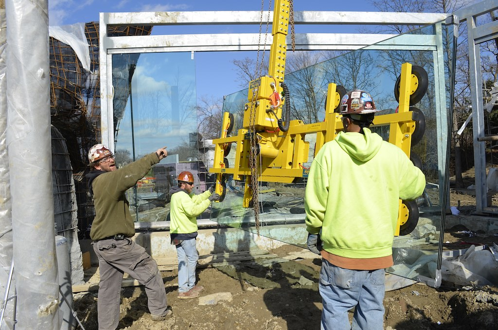 Installing glass in lion viewing area.