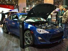 automobile(1.0), toyota 86(1.0), automotive exterior(1.0), exhibition(1.0), wheel(1.0), vehicle(1.0), automotive design(1.0), scion(1.0), auto show(1.0), mid-size car(1.0), land vehicle(1.0), luxury vehicle(1.0), sports car(1.0),
