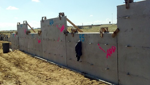 Photo of walls under construction on north approach to Green Valley Ranch Boulevard commuter rail bridge
