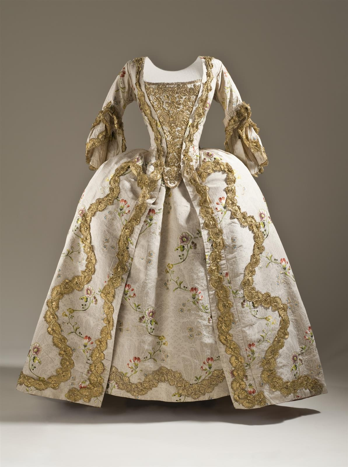 1760. Robe à la française. French. Silk plain weave (faille) with silk and metallic-thread supplementary weft patterning, and metallic lace trim. LACMA
