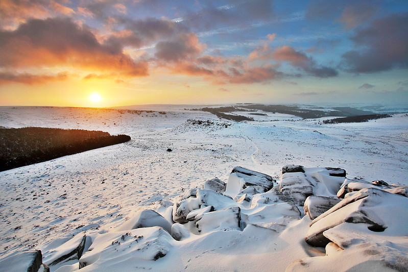 The view from Higger Tor to Carl Wark on a snow covered winter morning - on the South Yorkshire and Derbyshire border in the Peak District and Sheffield.
