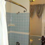 Tiled shower and tub in bath