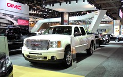 automobile, gmc, automotive exterior, exhibition, pickup truck, vehicle, truck, auto show, bumper, land vehicle, motor vehicle,