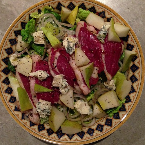 Salad with smoked duck breast, shallots, Bleu d'Auvergne, and pears.