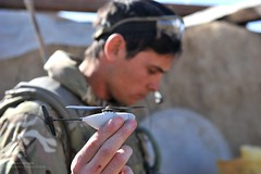 Soldier Operating Black Hornet Nano UAV Helicopter