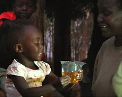 Child drinking ORS from Kit Yamoyo