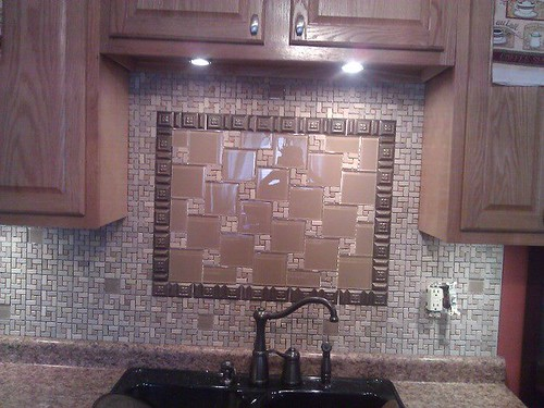 Natural stone and glass insert backsplash
