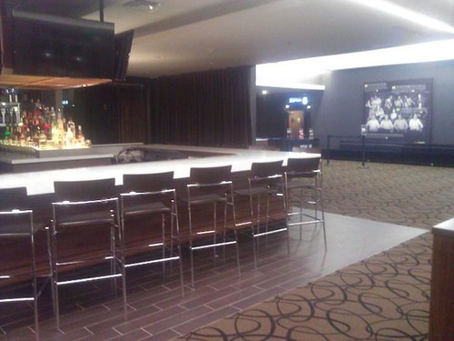 Porcelain planking tile bar area at Studio Movie Grill