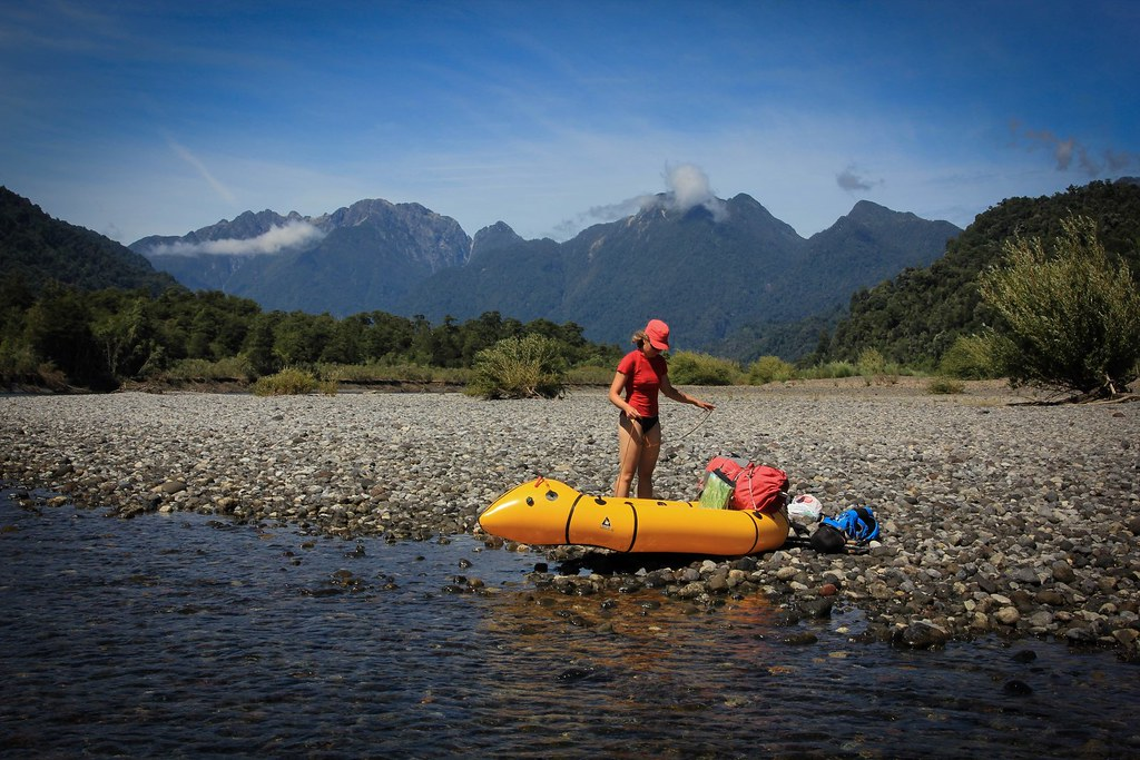 Taking a break along the shores of Rio Petrohue. Region de los Lagos. Chilean Patagonia.