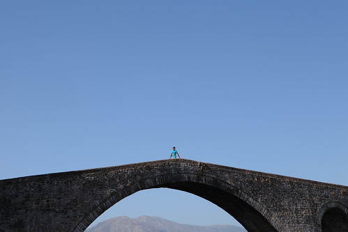 bridge summer vacation mountain man travelling horizontal stone outdoors person one scenery alone crossing view top perspective tourist greece slippery arta gefyri arachthos