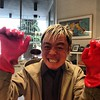 It's really not an opening until Kevin Chen puts on the vegetable scrubbing gloves!