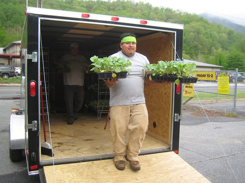 Volunteer George Welch unloads Garden Wagon plants.