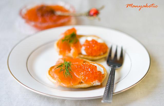 rye blinis with red caviar and salmon